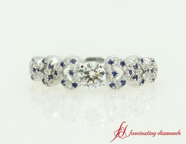 Round Diamond And Blue Sapphire Side Stone Ring