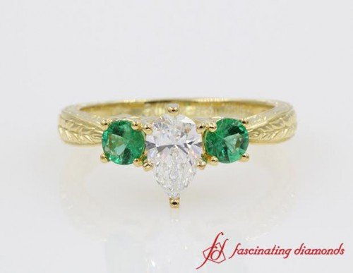 Pear Shaped Diamond Engagement Rings With Emerald Accents Fascinating Diamonds
