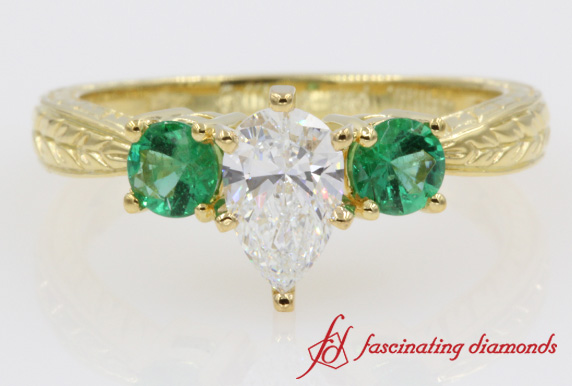 Pear Shaped Diamond & Emerald Ring