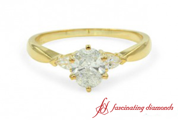 Oval And Pear Diamond 3 Stone Ring
