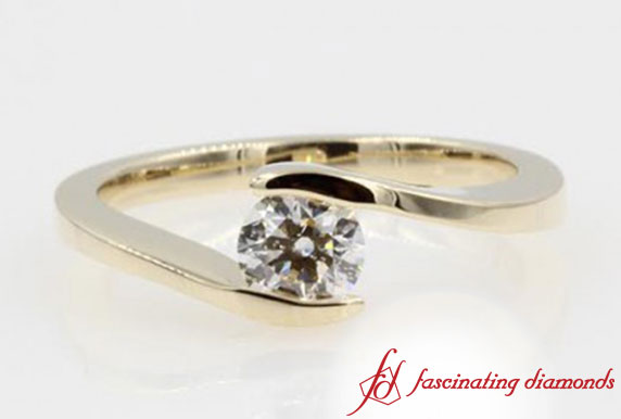 Tension Set Solitaire Engagement Ring In Yellow Gold
