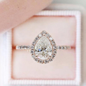 Wedding Ring With Pear Halo