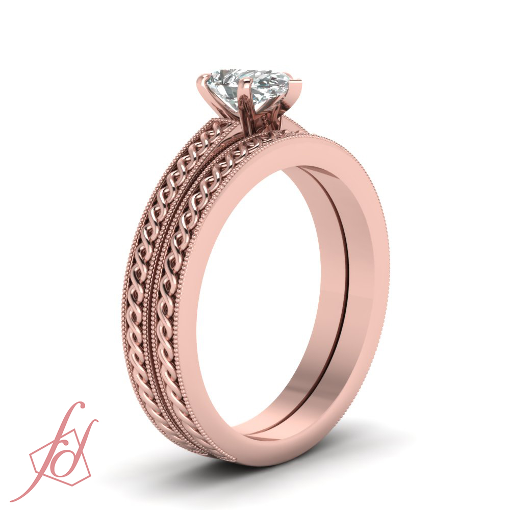 1 2 carat pear shaped diamond coiled design solitaire