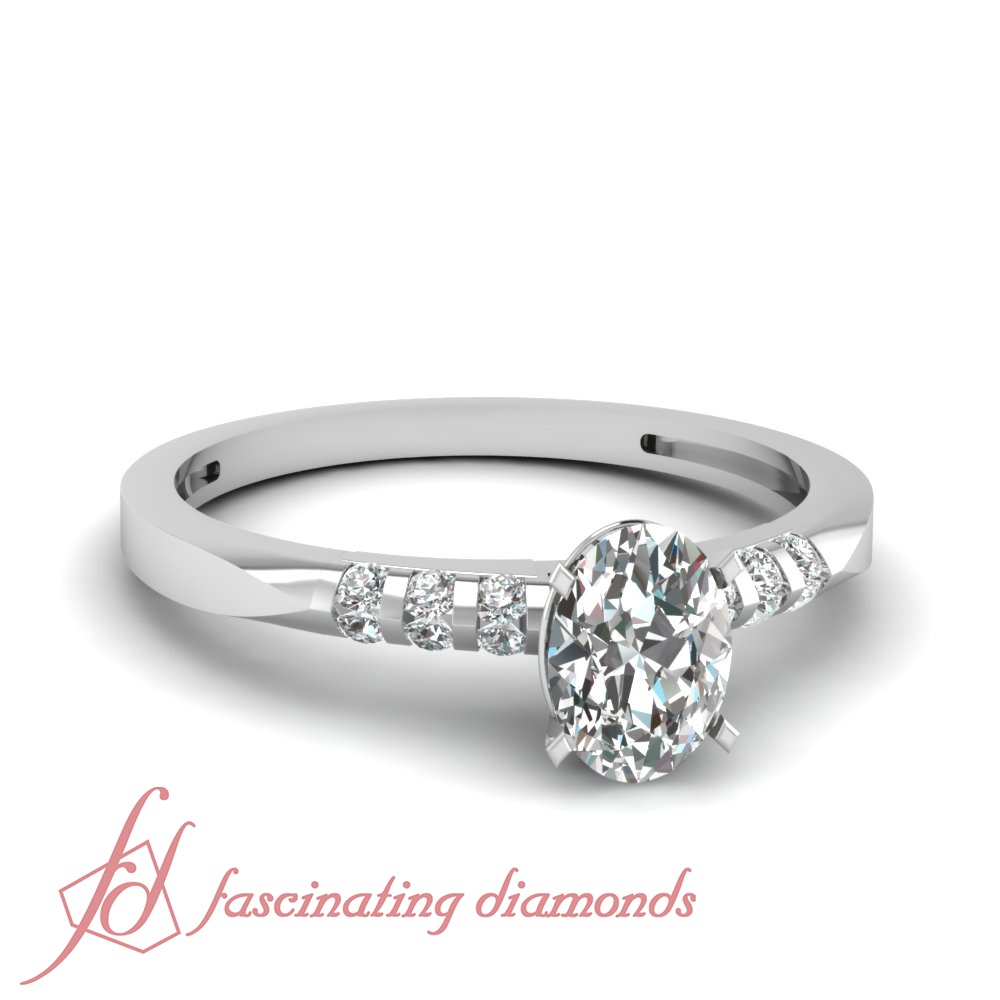 Unique Looking Engagement Ring Channel Set 0 65 Ct Oval Shaped Diamond VVS2 GIA