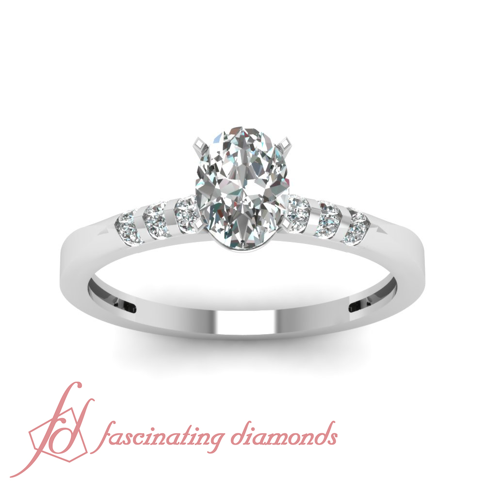 Unique Looking Engagement Ring Channel Set 0 65 Ct Oval Shaped Diamond VVS2 G